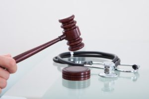 Gavel and Stethoscope | Medical Malpractice Lawsuit | Law Offices of P. Kent Eichelzer III